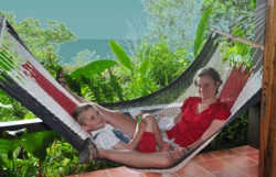 swinging in hammock on ocean view patio in La Paloma Lodge, Osa Peninsula