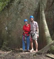 Fred and Skippy, aged 80 and 75 years, stand at the base of Abraham, just prior to ascending 110 feet to the canopy platform.